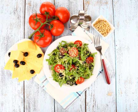 Fresh salad with arugula, close up photo