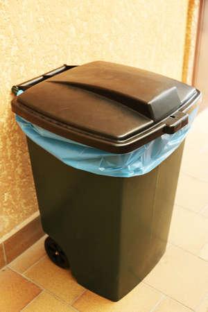segregate: Recycling bin on wall background
