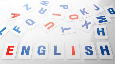 english language: Learning alphabet letters close up Stock Photo