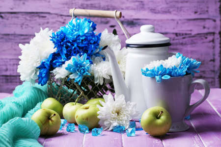 Composition of white and blue chrysanthemum and utensil close-up photo