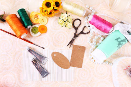 brads: Scrapbooking craft materials on light background