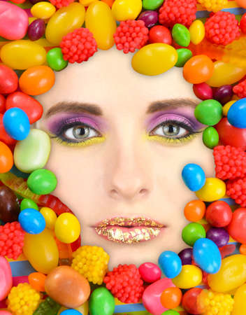 jelly head: Woman beauty face with sweets frame, close-up