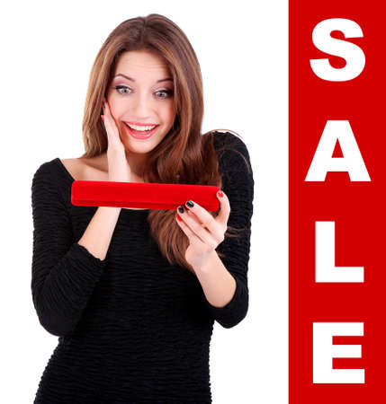Concept of discount. Girl looks at box with jewelry gift photo