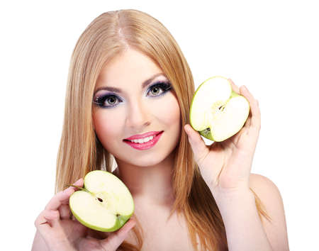 Beautiful young woman with glamour make up and apple, isolated on white photo