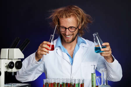 experimenter: Crazy scientist working in laboratory Stock Photo