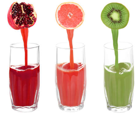 Juice pouring from fruits into glass, isolated on white photo