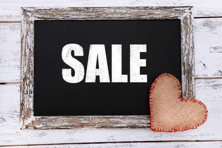 Sale writing on blackboard, close-up photo