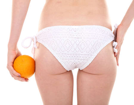 Young woman with orange isolated on white photo