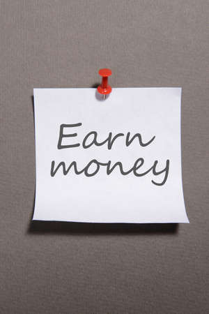 earn money: Paper sheet with inscription Earn money on grey background