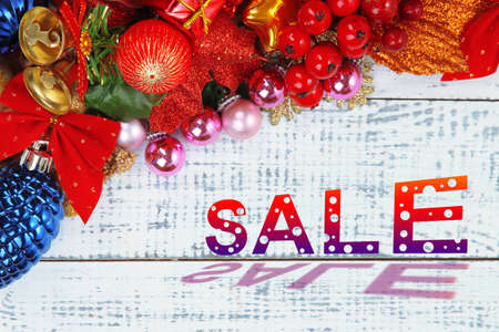 liquidation: Concept of discount. Christmas toys and decoration on wooden table close-up Stock Photo