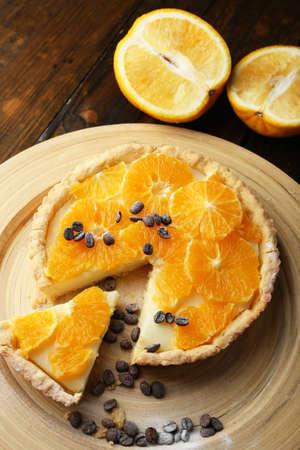 orange tart: Homemade orange tart with coffee grains on wooden background Stock Photo