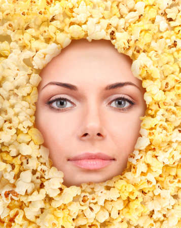 Woman beauty face with popcorn frame, close-up photo