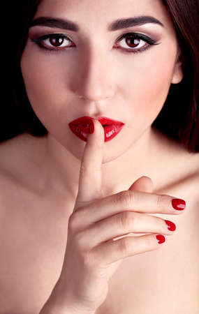 Girl with red lips and nails close-up photo