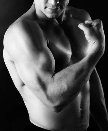 musculation: Sexy muscular man on dark background in shades of grey Stock Photo