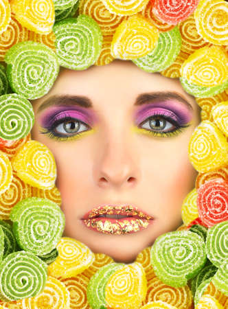 Woman beauty face with sweets frame, close-up photo