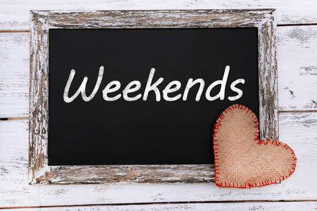Weekends written on chalkboard, close-up photo