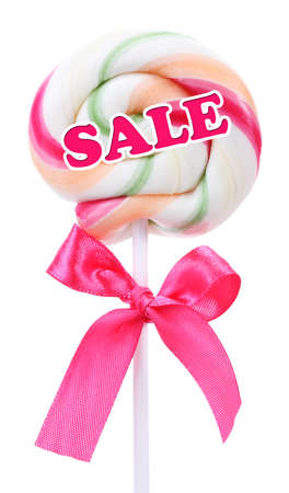 Sale concept. Colorful lollipop with bow isolated on white photo
