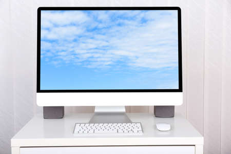 Computer with screensaver on table photo