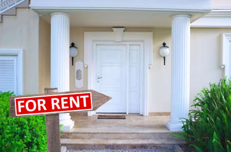 house for rent: Real estate sign in front of new house for rent