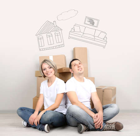 cardboard house: Dreaming concept. Young couple moving in new house