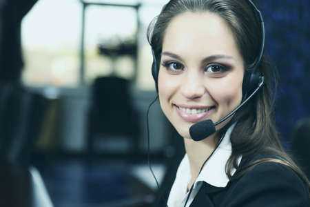 to phone calls: Call center operator at work