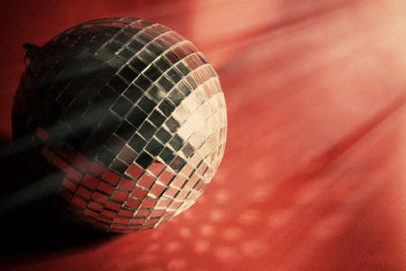 Disco ball on red background photo