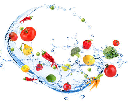 Fresh vegetables with water splash, isolated on white photo