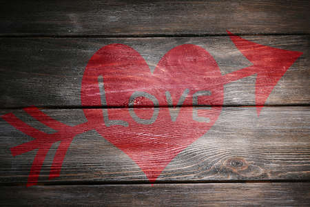 Love concept. Inscription on wooden wall background