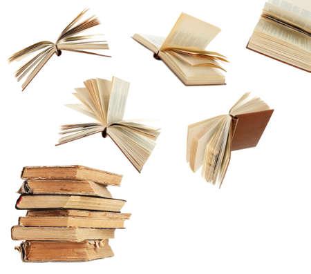 libros: Libros de vuelo aislado en blanco