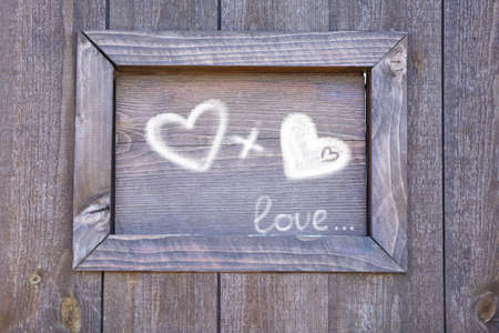 fondness: Love concept. Drawing on wooden wall background Stock Photo