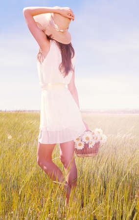 Portrait of beautiful young woman in field photo