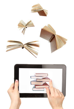 Information transfer.Books flying in tablet isolated on white photo