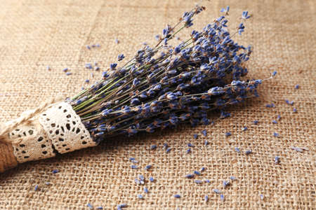 Lavender flowers on sackcloth background photo