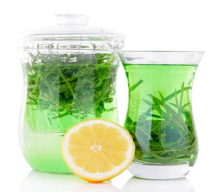 Estragon drink with lemon isolated on white photo
