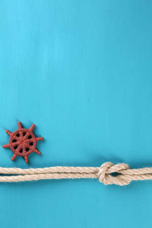 Marine knot on color wooden background photo