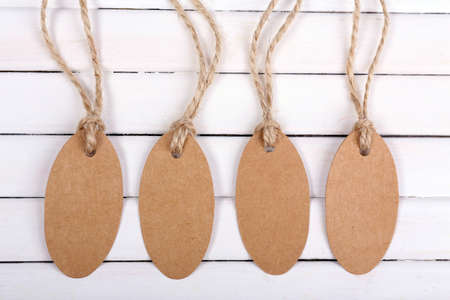 empty tags on white wooden background photo