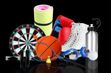sporting goods: Art�culos de deporte sobre fondo negro Foto de archivo