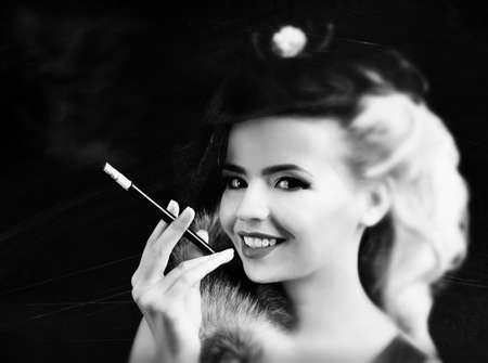 Beautiful woman in retro style, on dark background Stock Photo