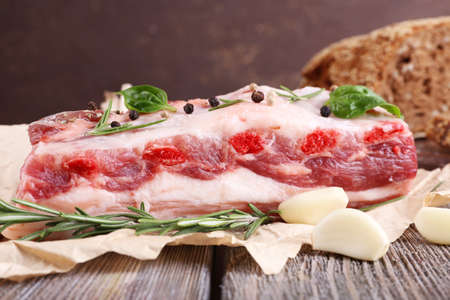 belly pepper: raw bacon with bread and spices on wooden table Stock Photo