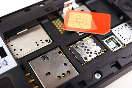 cell phone and two sim cards, close up photo