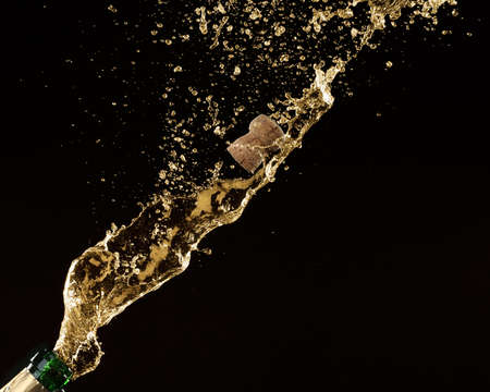 luxury background: Champagne splashes with cork on black background