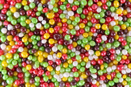 Colorful sugar sprinkles background photo