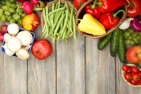 organic background: Summer frame with fresh organic vegetables and fruits on wooden background