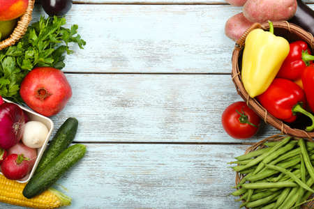 Summer frame with fresh organic vegetables and fruits on wooden background photo