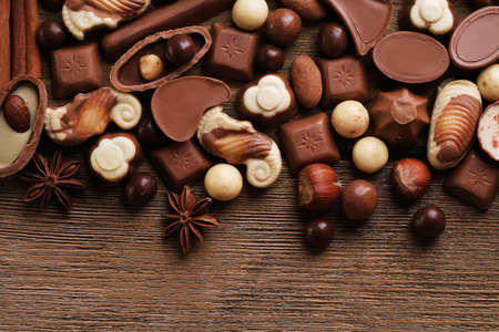 chocolate sweet: Different kinds of chocolates on wooden table close-up