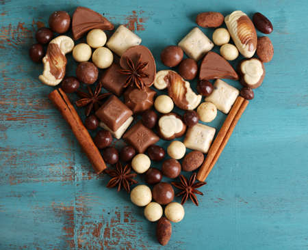 candy hearts: Different kinds of chocolates on wooden table close-up