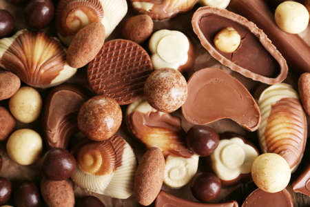 Different kinds of chocolates close-up background photo