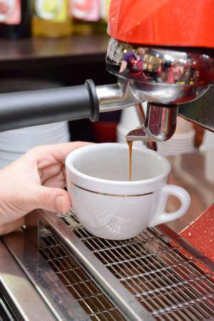 Woman preparing coffee, close up photo