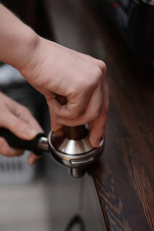 Woman preparing cup of coffee, close up photo