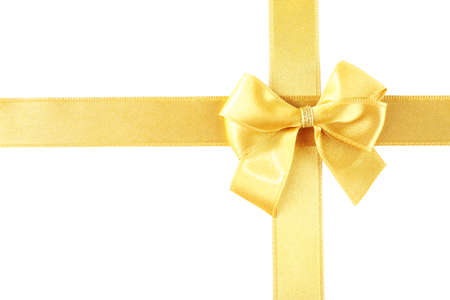 Golden ribbon and bow isolated on white photo